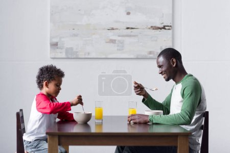 father and son eating breakfast