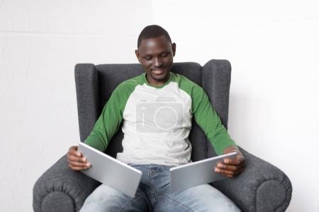 Man with two digital tablets