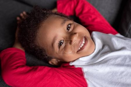 relaxed smiling afro kid