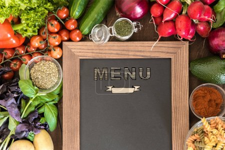 Photo for Chalkboard with set of ingredients and spices for cooking Italian pasta from above view. Food preparation background - Royalty Free Image