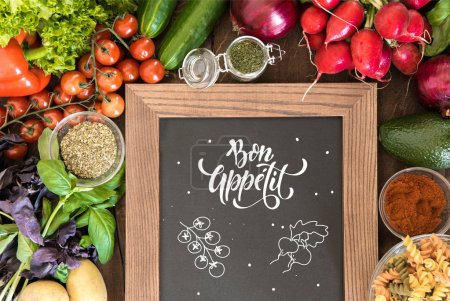 chalkboard with group of fresh vegetables