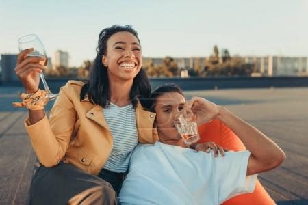 couple with glasses of alcohol