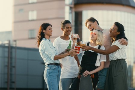 Friends drinking alcohol on roof