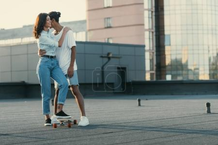 Couple embracing on rooftop