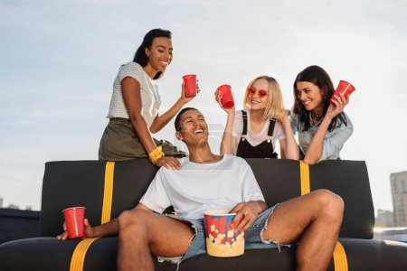 women flirting with young man on party