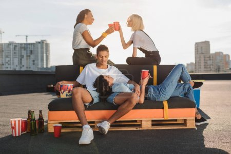 Friends relaxing on roof