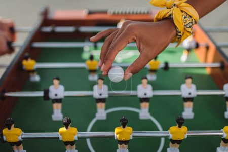 woman holding ball for table football