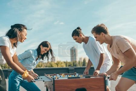 friends playing table football