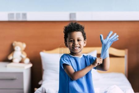 african american boy wearing medical glove