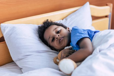 african american boy with teddy bear