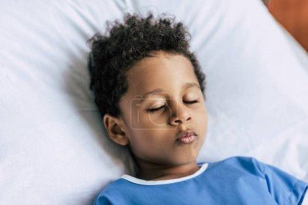 african american boy sleeping in bed