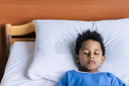 african american boy sleeping in bed