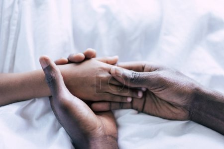 Photo for Partial view of african american father and son holding hands together - Royalty Free Image