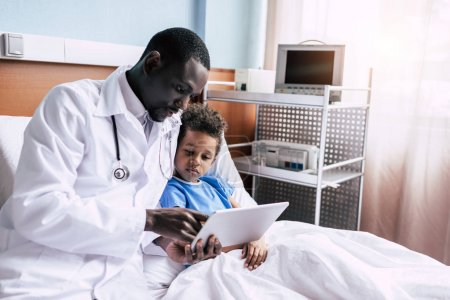 african american doctor and patient with tablet