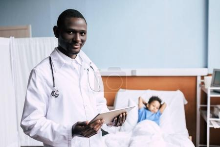African american doctor with tablet