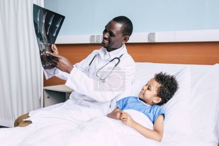 african american doctor and patient with xray picture
