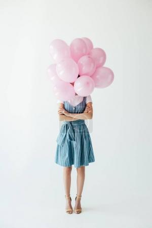 Photo for Obscured view of woman with arms crossed and bunch of pink balloons isolated on grey - Royalty Free Image