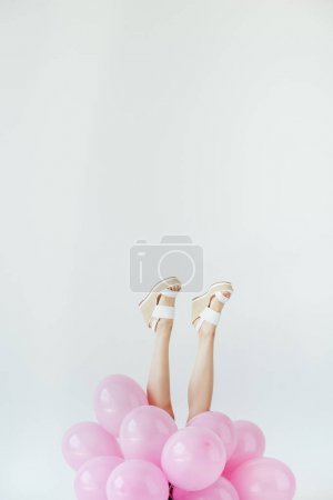 female legs and balloons