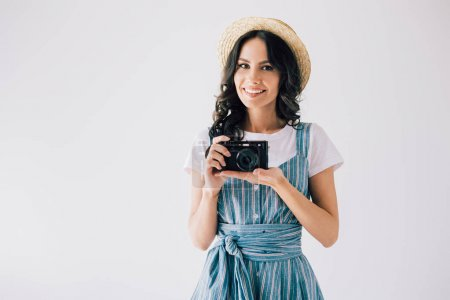 Smiling woman with photo camera