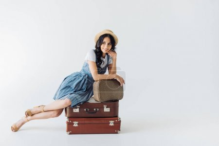 smiling woman with luggage
