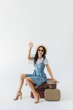 Woman waving to someone