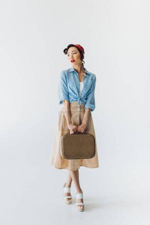 stylish asian woman with suitcase