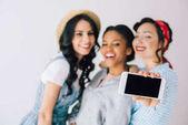 multicultural women taking selfie