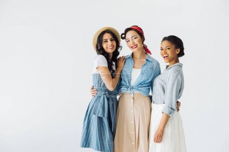 Photo for Portrait of beautiful multicultural women in retro clothing looking at camera isolated on grey - Royalty Free Image
