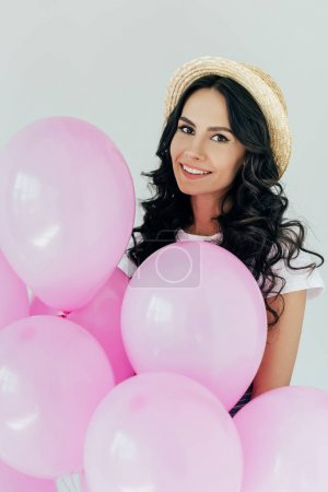 Woman in straw hat with balloons