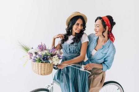 multicultural women on bicycle