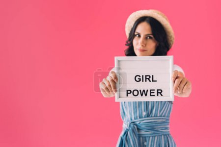 woman with girl power board in hands