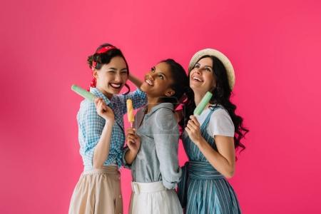 Photo for Portrait of multicultural stylish women with popsicles isolated on pink - Royalty Free Image