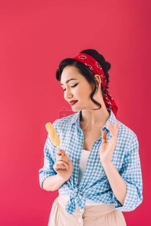 Photo for Portrait of stylish smiling asian woman with popsicle isolated on pink - Royalty Free Image