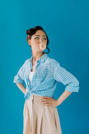 asian woman blowing bubble gum