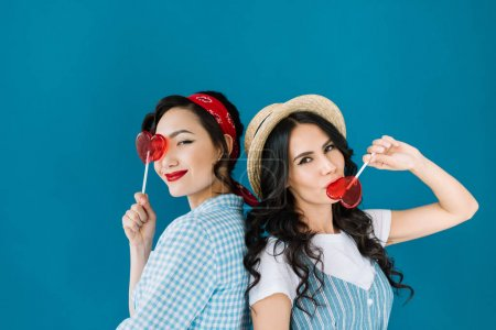 Photo for Portrait of multicultural women with lollipops isolated on blue - Royalty Free Image