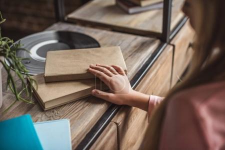 kid taking book