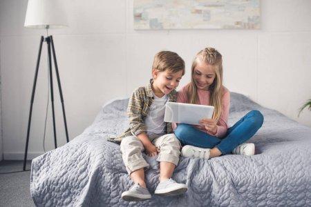 Kids using tablet together