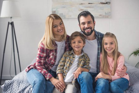 Photo for Portrait of smiling family looking at camera at home - Royalty Free Image
