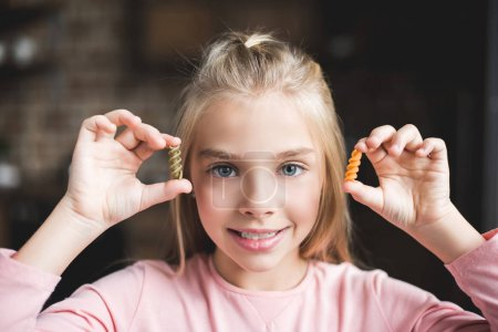 Little kid with macaroni