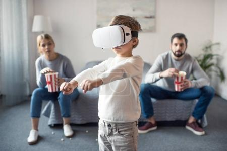 kid playing in vr headset