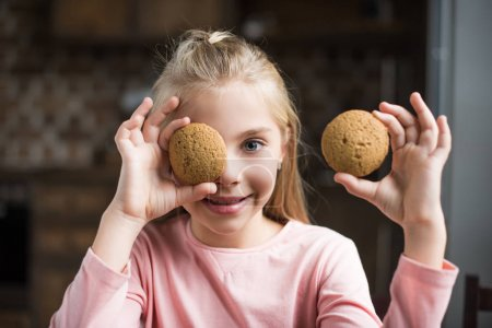 smiling child with cookies