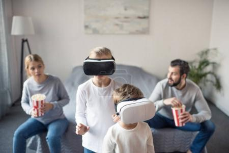kids in vr headsets at home
