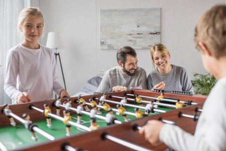 family playing table football together