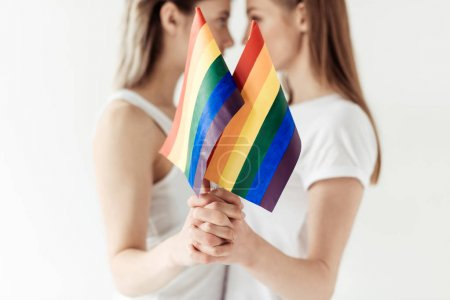 Lesbian couple with small rainbow flags