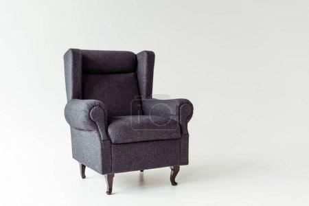 Foto de Un sillón gris en un piso blanco y la pared - Imagen libre de derechos