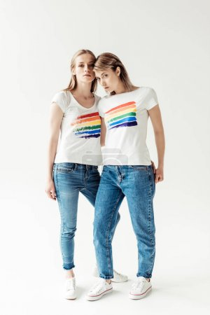 Women in white shirts with printed rainbow