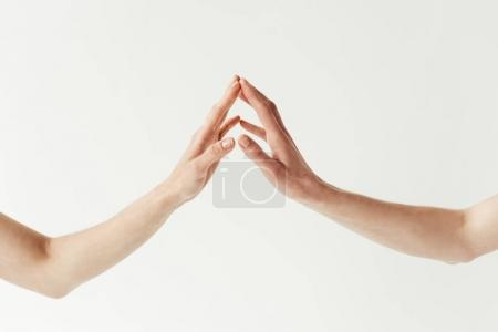 lesbian couple touching hands