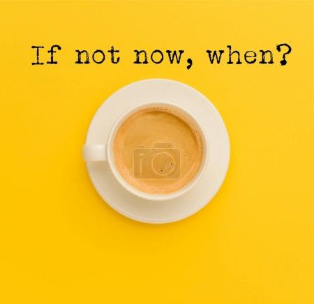 Photo for Top view of cup of fresh hot coffee isolated on yellow - Royalty Free Image