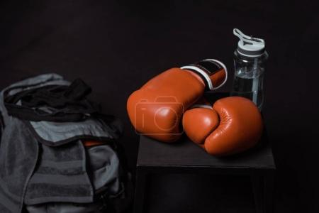 boxing gloves and sports bottle