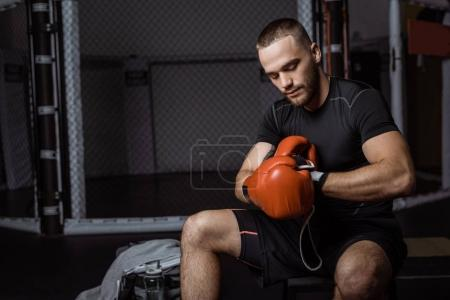 muscular sportsman in boxing gloves